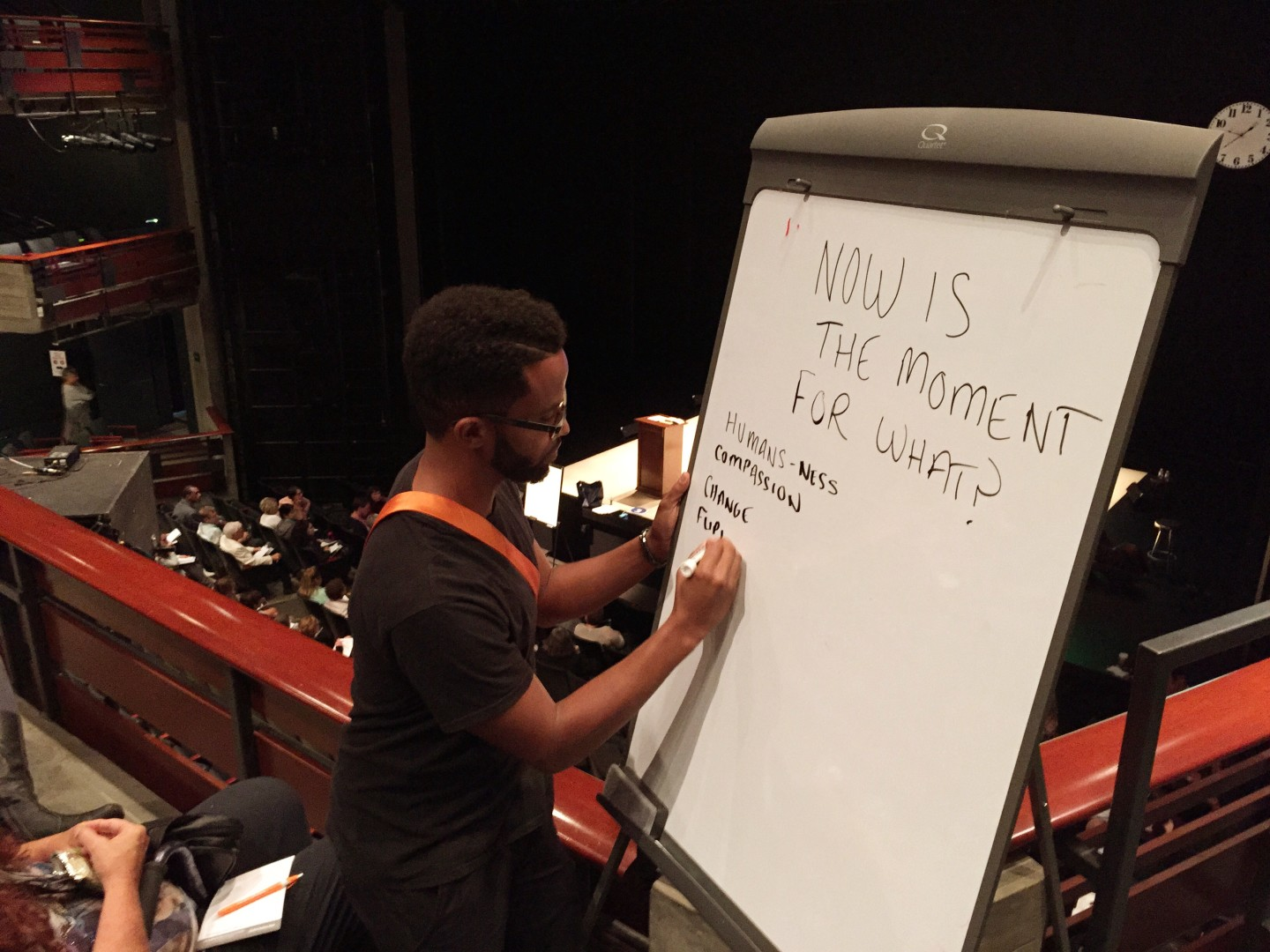 "Poet Dahlak Brathwaite at the whiteboard during Anna Deveare Smith's ""Notes from the Field: Doing Time in Education, The California Chapter."""