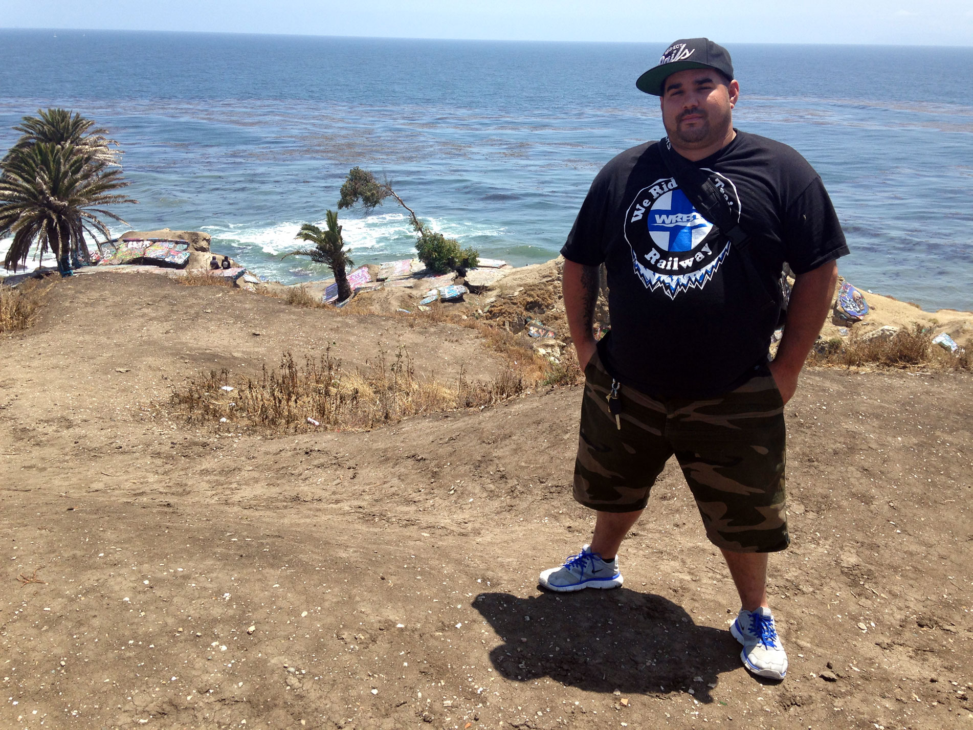 """Anthony Bora likes to explore Sunken City's winding trails and graffiti, and admire the view. """"This is one of the most beautiful views that I've seen in Southern California,"""" he said."""