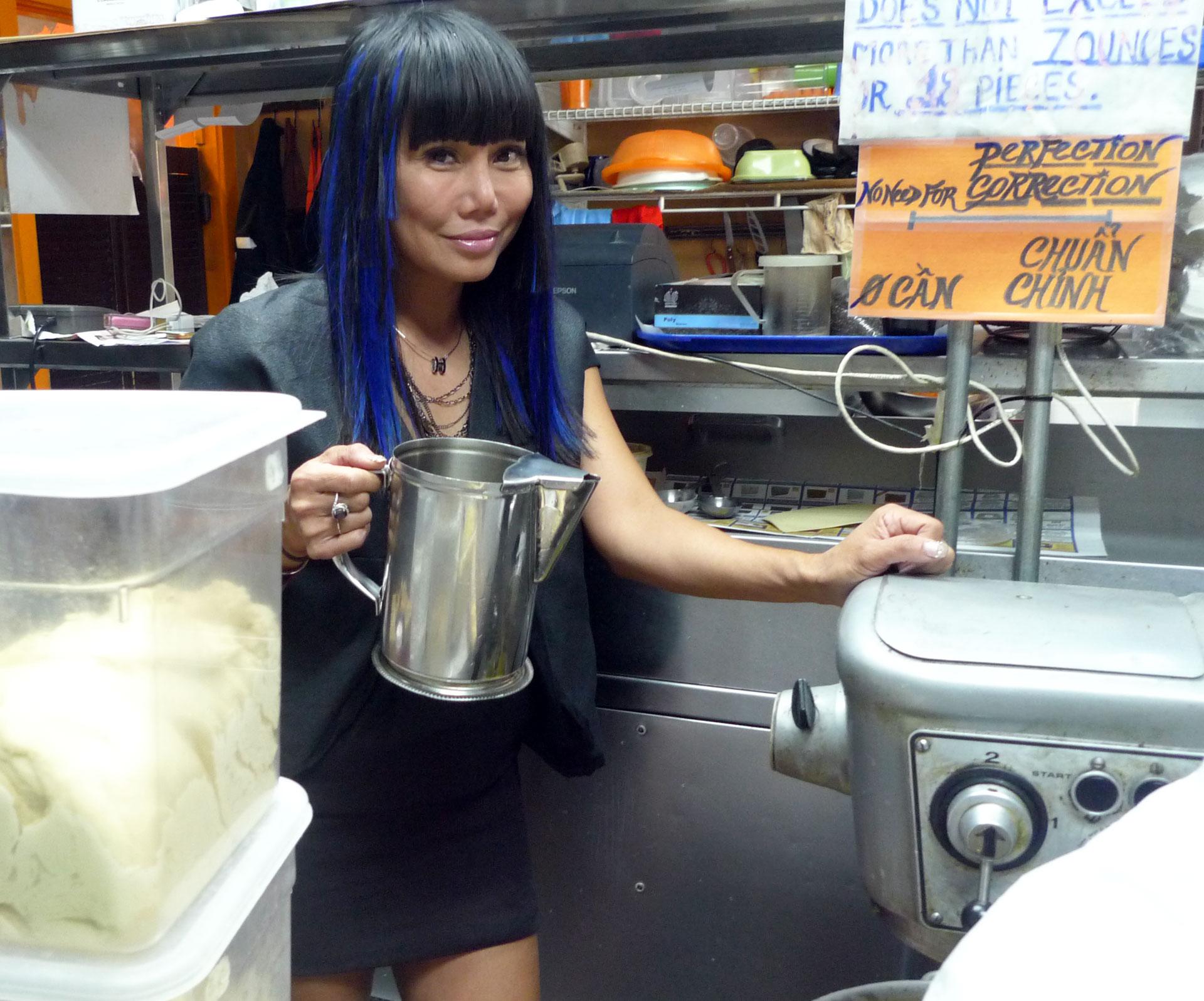 Lynda Trang Dai in the kitchen of her bánh mì shop, Lynda Sandwich, in Westminster.