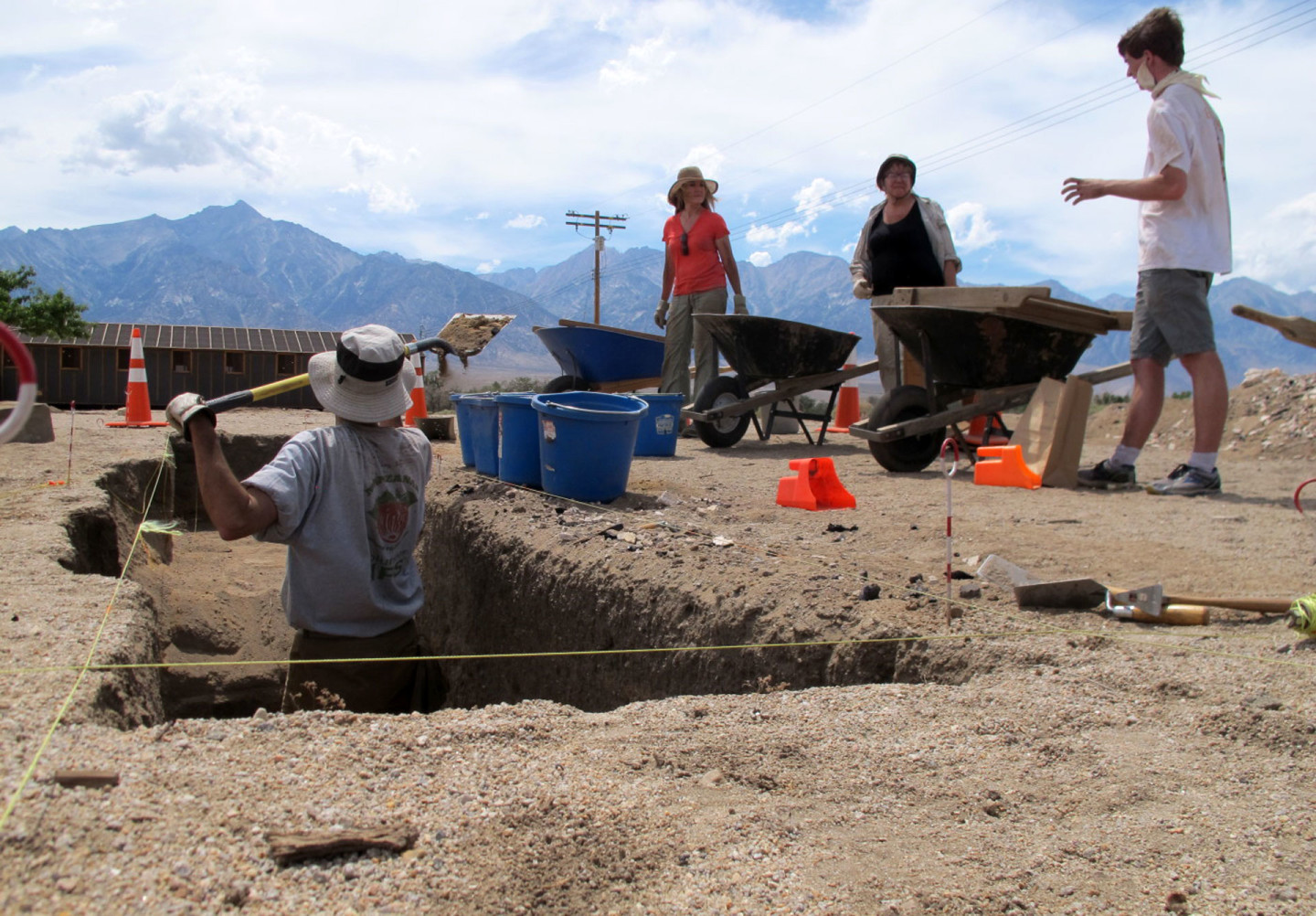 Volunteers dig and sift through the remains of a hand-dug basement, underneath a barrack, at the Manzanar National Historic Site in July. Most of the archaeological sites uncovered at the park have been dug by volunteers.