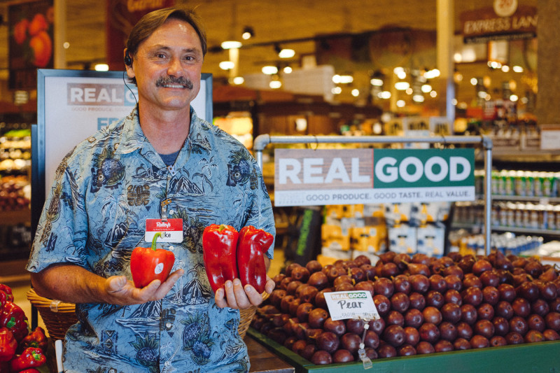 "Mike Selepec, produce team leader at Raley's, holds a $2 ""perfect"" red pepper next to ""imperfect"" peppers, which sell for $1.19 per pound."