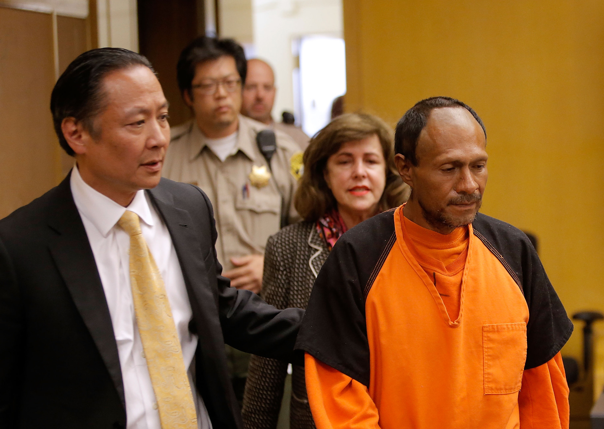 Francisco Sanchez, right, enters court for an arraignment with San Francisco Public Defender Jeff Adachi on July 7 in San Francisco.