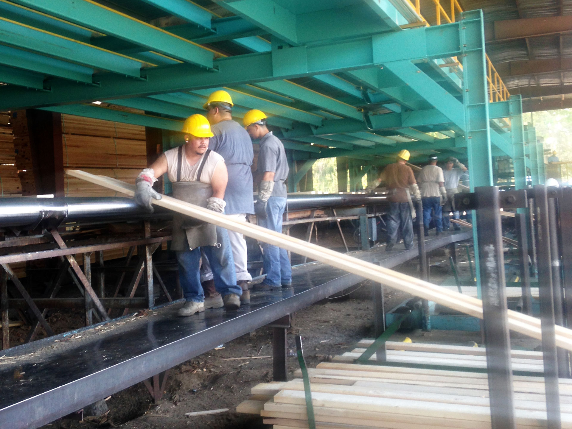 Workers at Sierra Forest Products get lumber ready for shipments.
