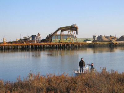 View of the Sims Metal Management facility across Redwood Creek.