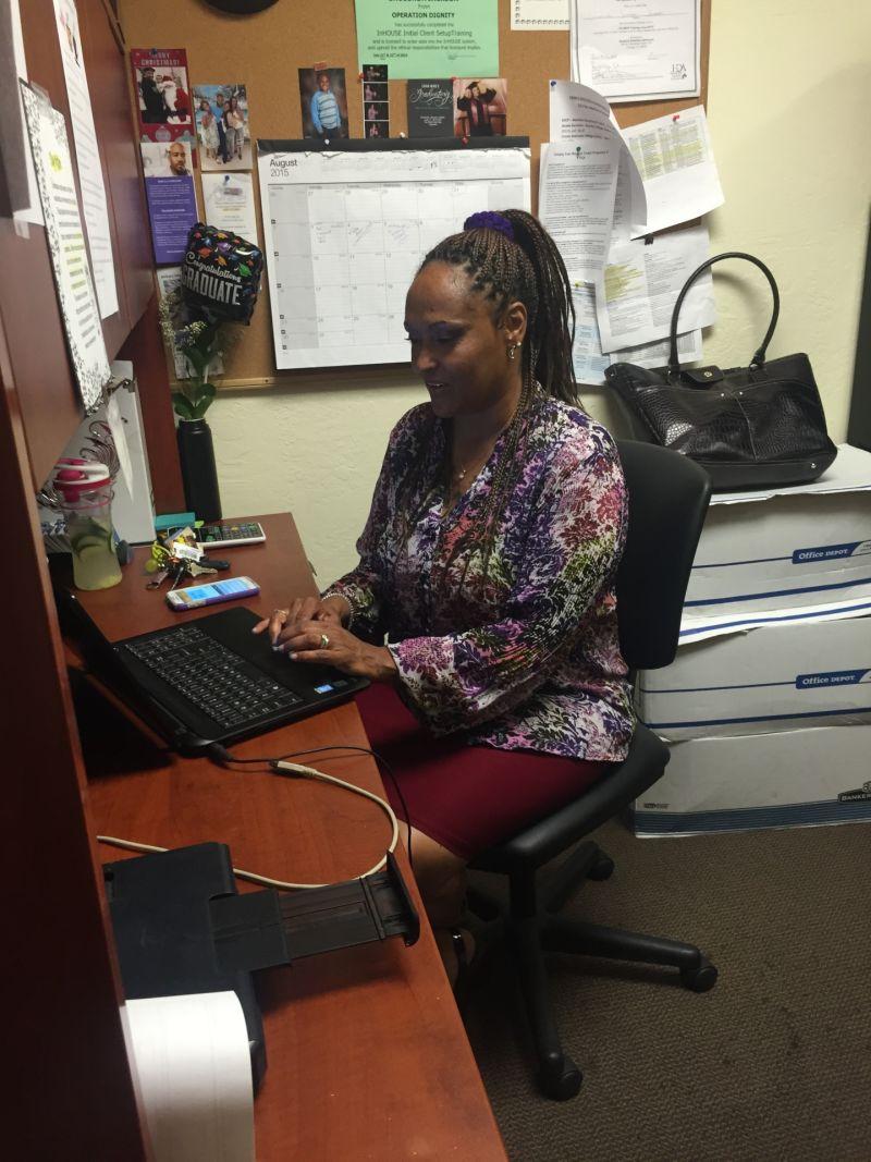 Sholonda Jackson sits at her desk in Oakland.