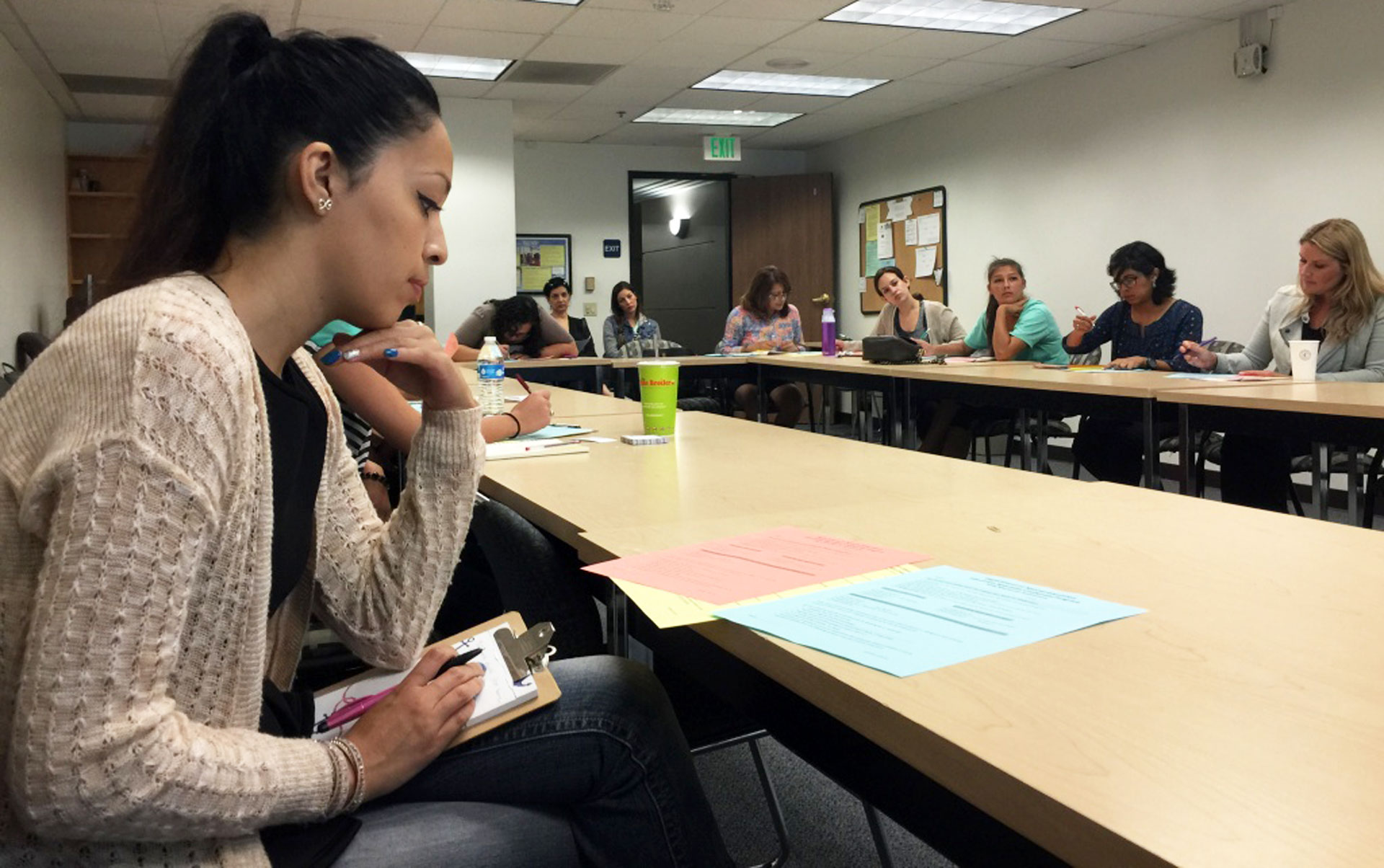 Women at Cal State Fullerton attend a recruiting event. The state is facing a shortage of teachers, due in part to declining enrollment in teacher preparation programs.