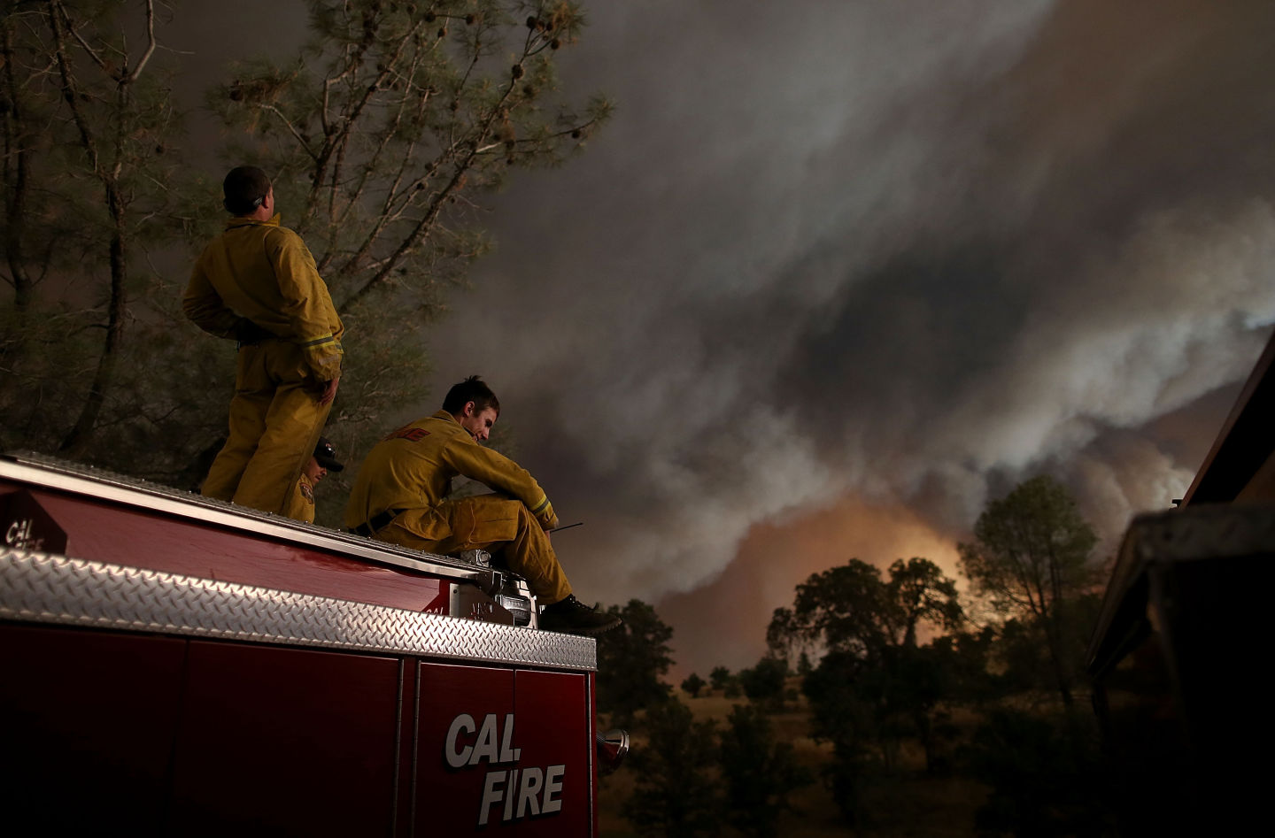 Members of a Cal Fire crew take a break Saturday as the Rocky Fire continued to spread through the countryside east of Clear Lake.  Justin Sullivan/Getty Images