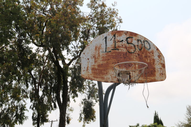 The park's tattered basketball hoops have sat unused for over a decade.