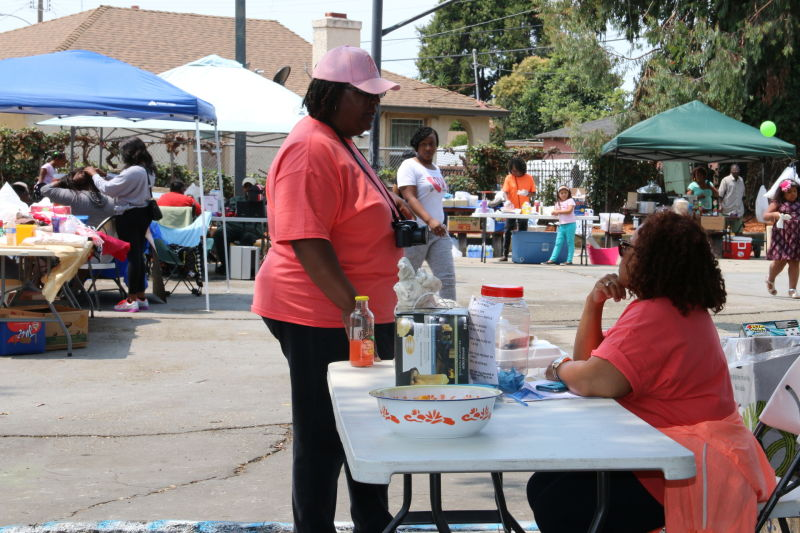 Cynthia Arrington, right, sells raffle tickets at the entrance to the park.
