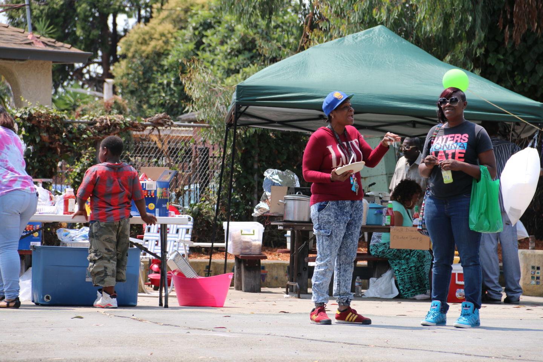 Neighbors enjoy Tyrone Carney Park's one-day opening.