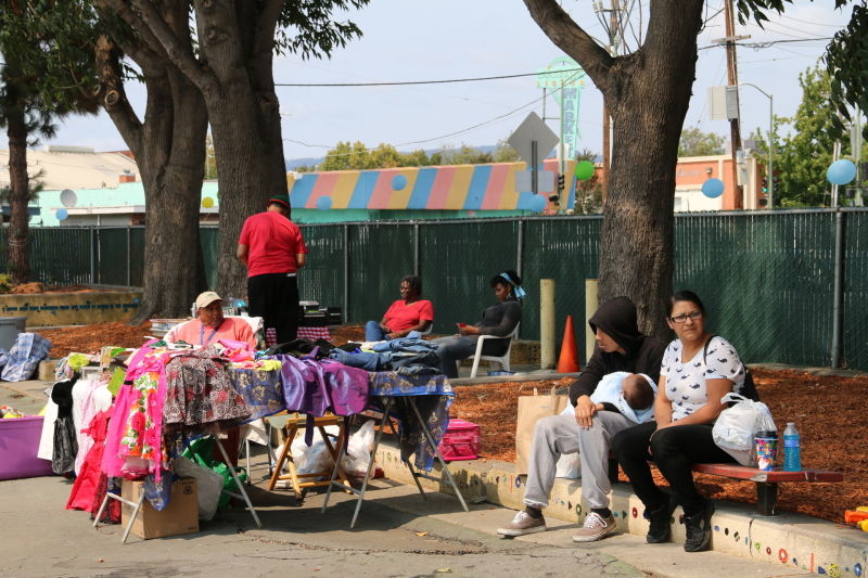 For one day only, community residents have opened their neighborhood park, closed for 13 years, for a garage sale.