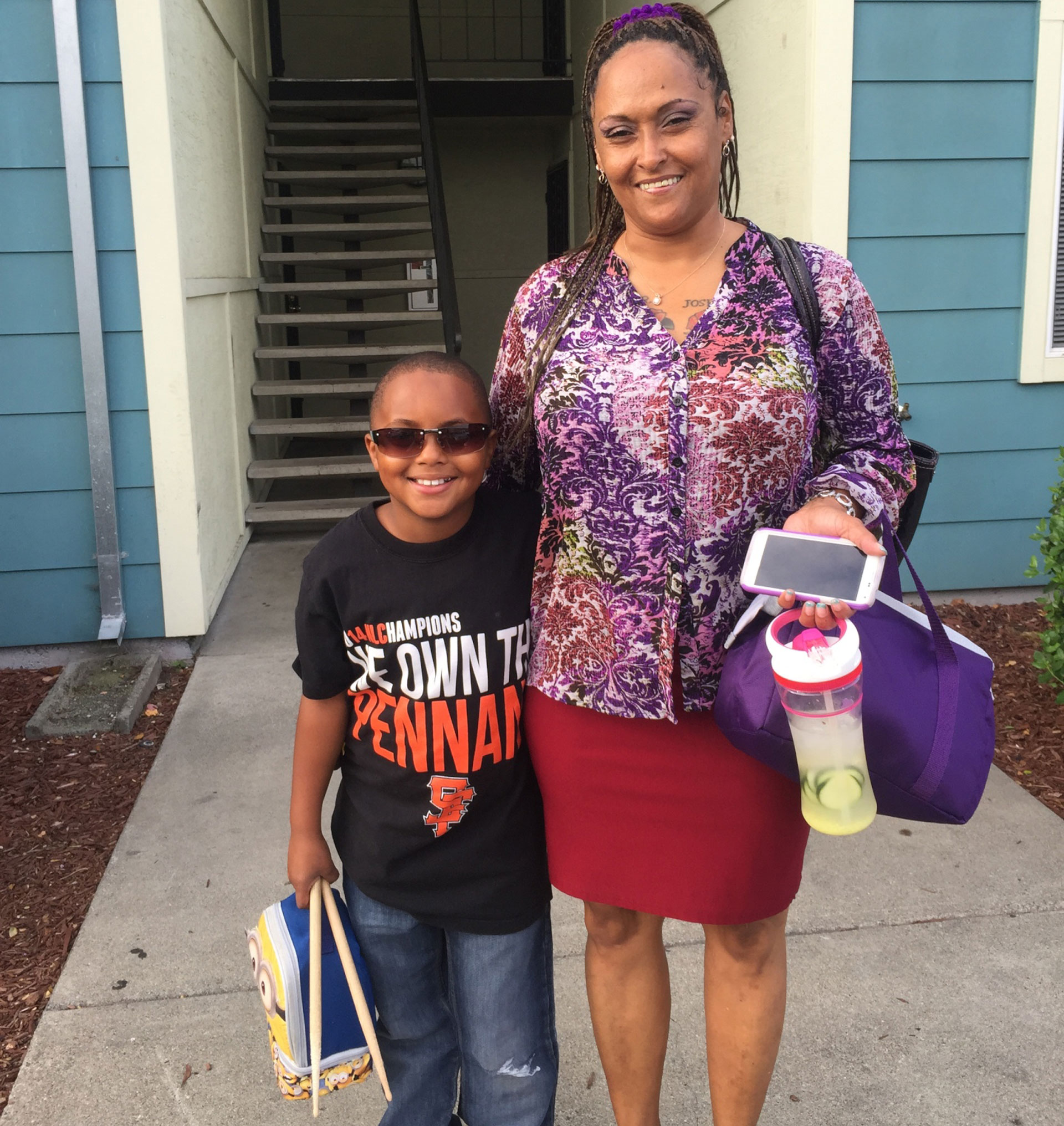 Sholonda Jackson and her son, Joseph, outside their Hayward home.