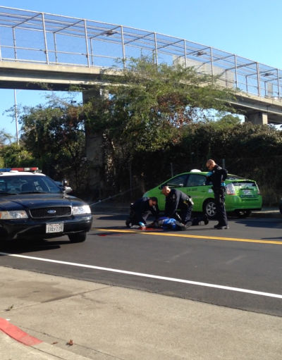Oakland police officers perform CPR on man shot by an officer after a confrontation near the Grand Lake neighborhood Thursday morning.