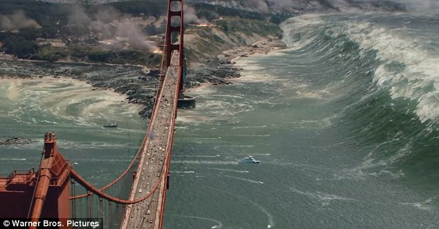 A 500-foot tsunami surges toward the Golden Gate Bridge in the summer action movie 'San Andreas.'