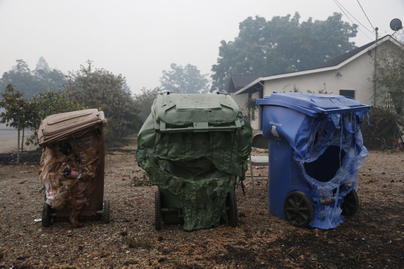 Melted garbage containers damaged by the Valley Fire sit near homes in Middletown, California. (Stephen Lam/ Getty Images)