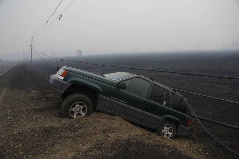 An abandoned vehicle sits along Highway 29 during the Valley Fire on September 13, 2015 in Middletown, California. (Stephen Lam/ Getty Images)