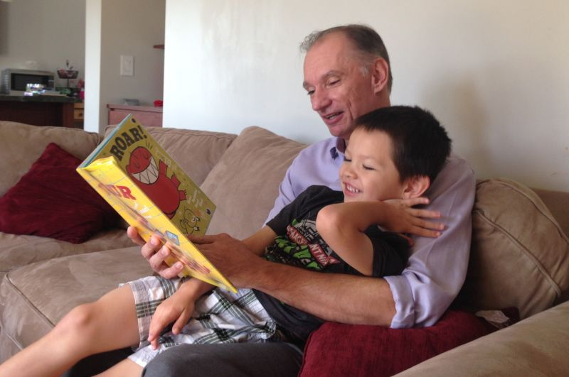 Bill Magoolaghan reads to his 4-year-old son, Cole, at their rebuilt home in San Bruno.