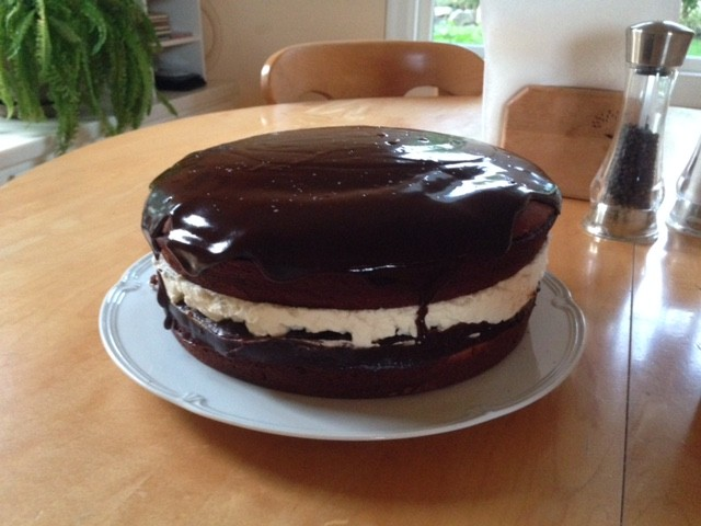 A chocolate cake with a chocolate ganache glaze and vanilla whipped cream center. Cindy now channels her energy into pursuits like baking that get a positive reaction from her mom and other family members.
