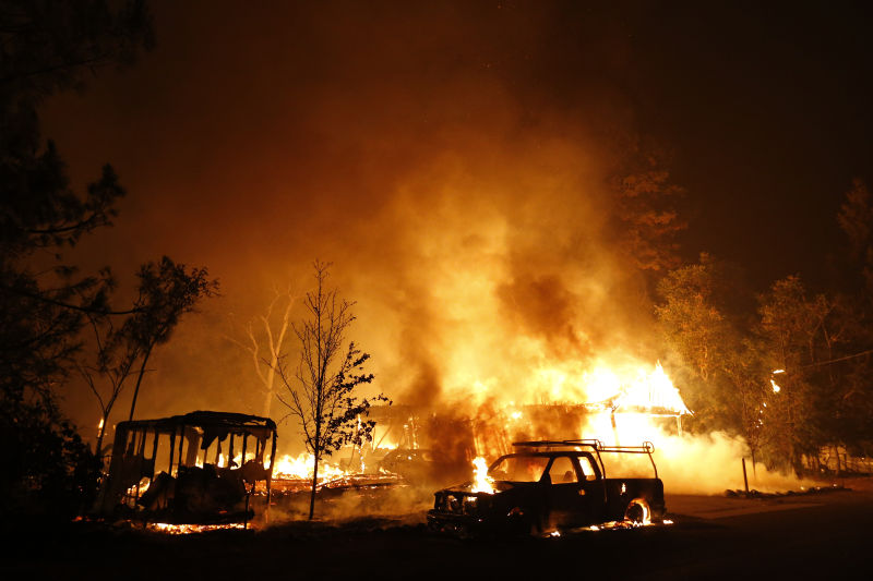 A car burns in front of a burning home during Valley Fire on September 13, 2015 (Stephen Lam/ Getty Images)