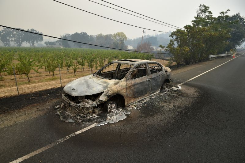 Melted metal flows from a burned out car abandoned on a highway during the Valley fire in Middletown, California. (Josh Edelson/AFP/Getty Images)