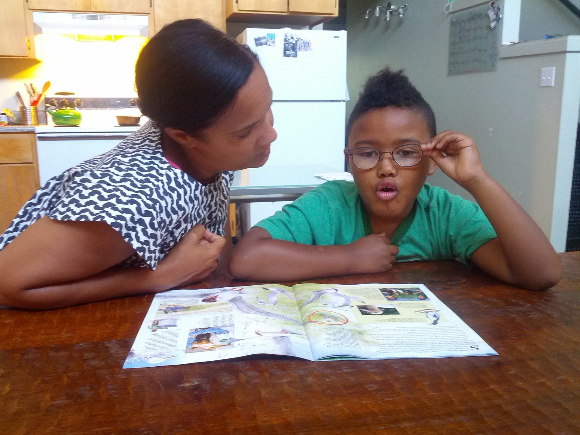 Maya Mosley-Katakanga listens as her son, Pharroh, a special ed student, does some reading.