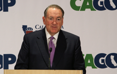 Former Arkansas Gov. Mike Huckabee speaks to reporters on Sept. 18 at the California Republican Party convention.