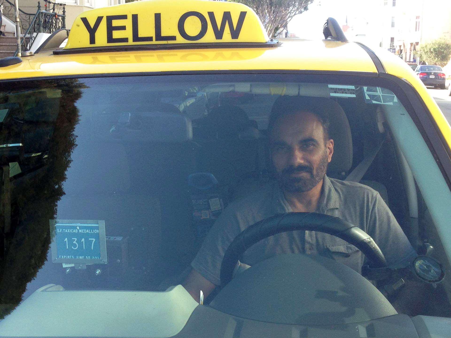 Taxi driver Harbir Batth feels trapped by the medallion he waited over a decade to buy.