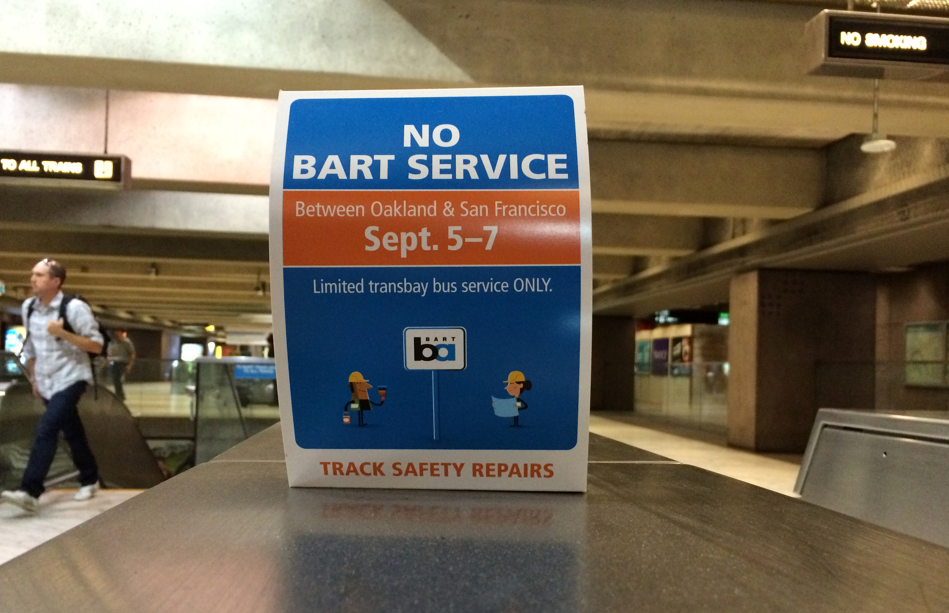 BART is using pop-up signs on turnstiles to advertise this weekend's transbay closure. (Susan Cohen/KQED)