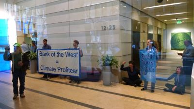 Protesters locked to each other in the Bank of the West lobby
