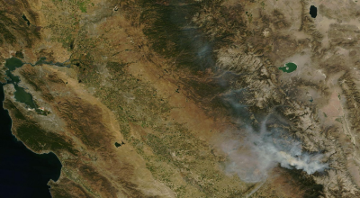 NASA satellite view showing smoke from the Rough Fire spreading north and west over the Sierra Nevada and San Joaquin Valley. (Click for larger image.)