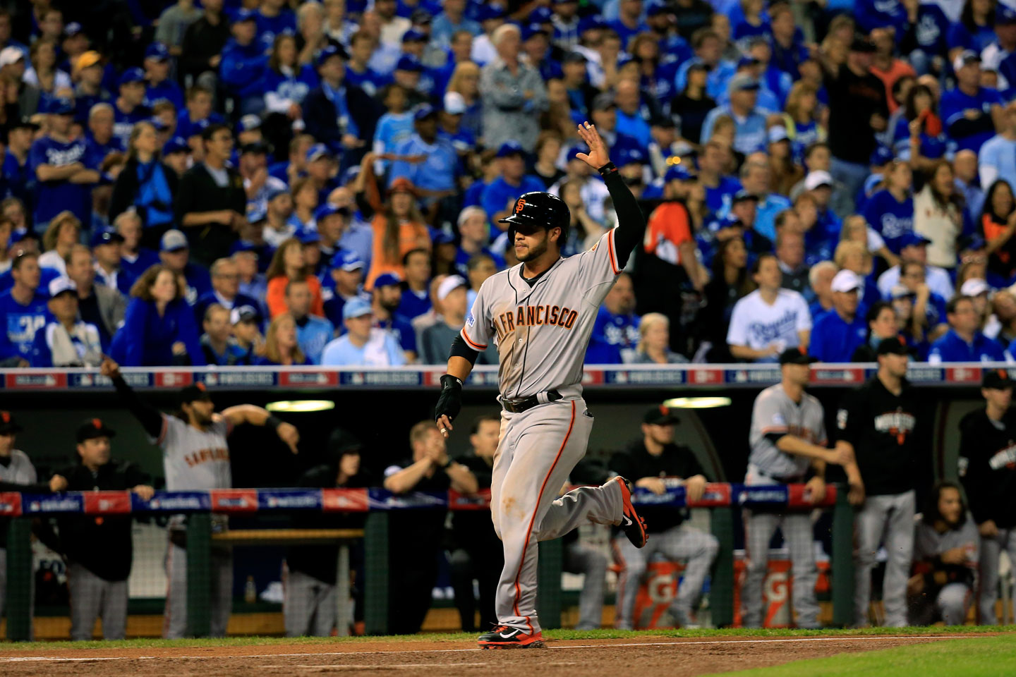 Gregor Blanco, who had singled to lead off the game, trots across the plate on a Pablo Sandoval double in the top of the first. Giants 1, Royals 0.  (Rob Carr/Getty Images)