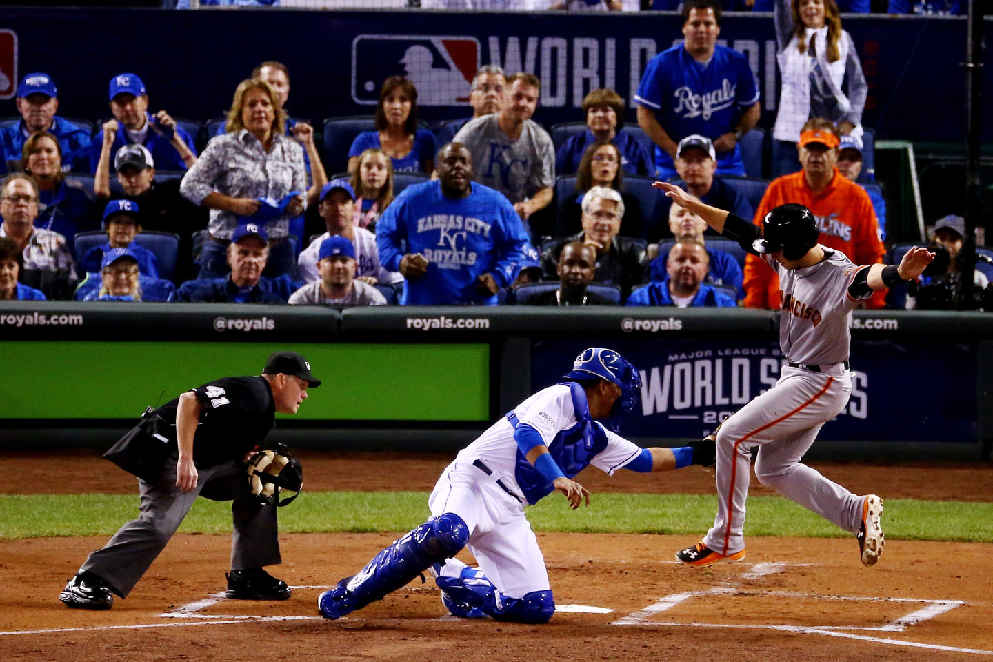 Buster Posey also tried to score on Sandoval's double in the top of the first, but was out by a mile. (Elsa/Getty Images)