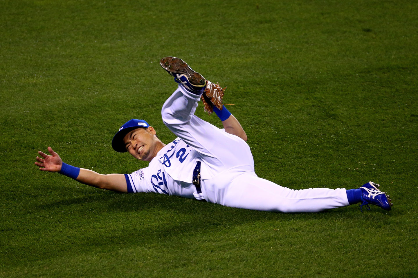 Royals right fielder Nori Aoki sprawls helplessly after misplaying a blistering one-hop drive in the gap by the Giants' Joe Panik. Gregor Blanco scored on the play. Panik wound up on third with a triple and later scored on Pablo Sandoval's single. Giants 7, Royals 0. (Elsa/Getty Images)