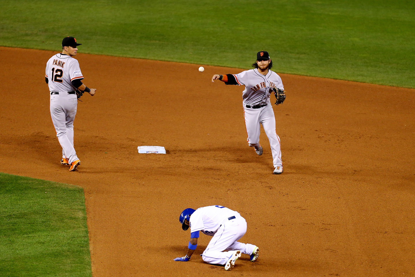 Brandon Crawford fires to first to complete a 4-6-3 double play in the eighth inning. (Ed Zurga/Getty Images)