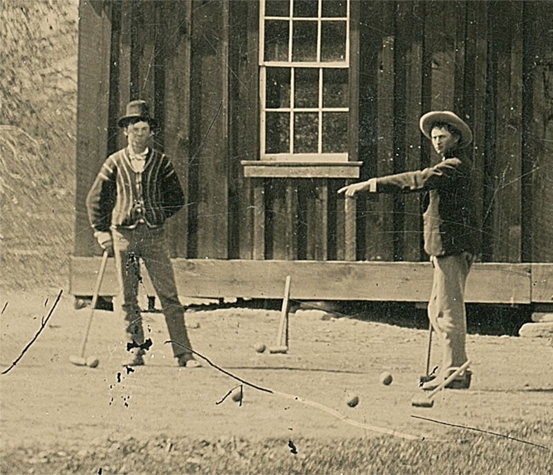 A detail of Billy the Kid (L) in the original tintype.
