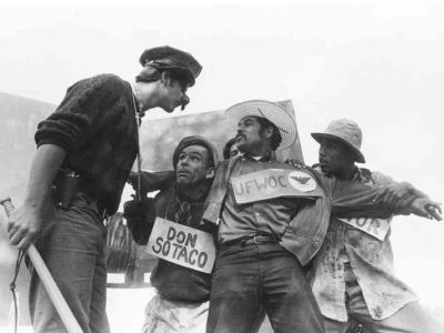 """Luis Valdez (center) performs with his """"Farmworkers Theatre"""" on a flatbed truck in the Central Valley in 1967."""
