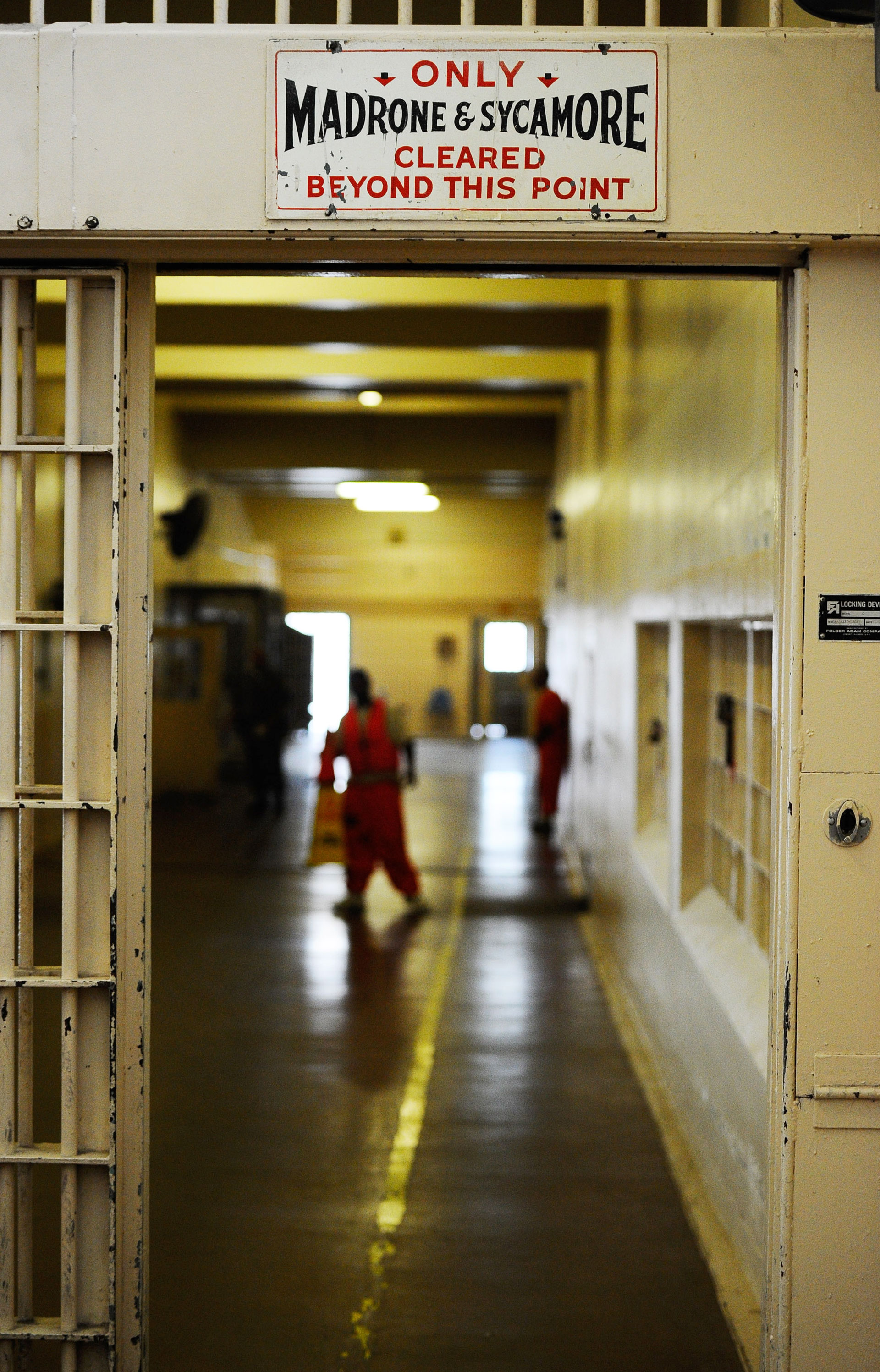 Inmates at Chino State Prison walk the hallway.