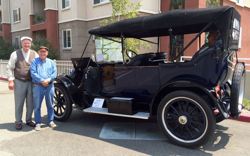 BAHCC President Eric Lundquist (L) and club member John Morrison stand next to Morrison's 103-year-old Cadillac.