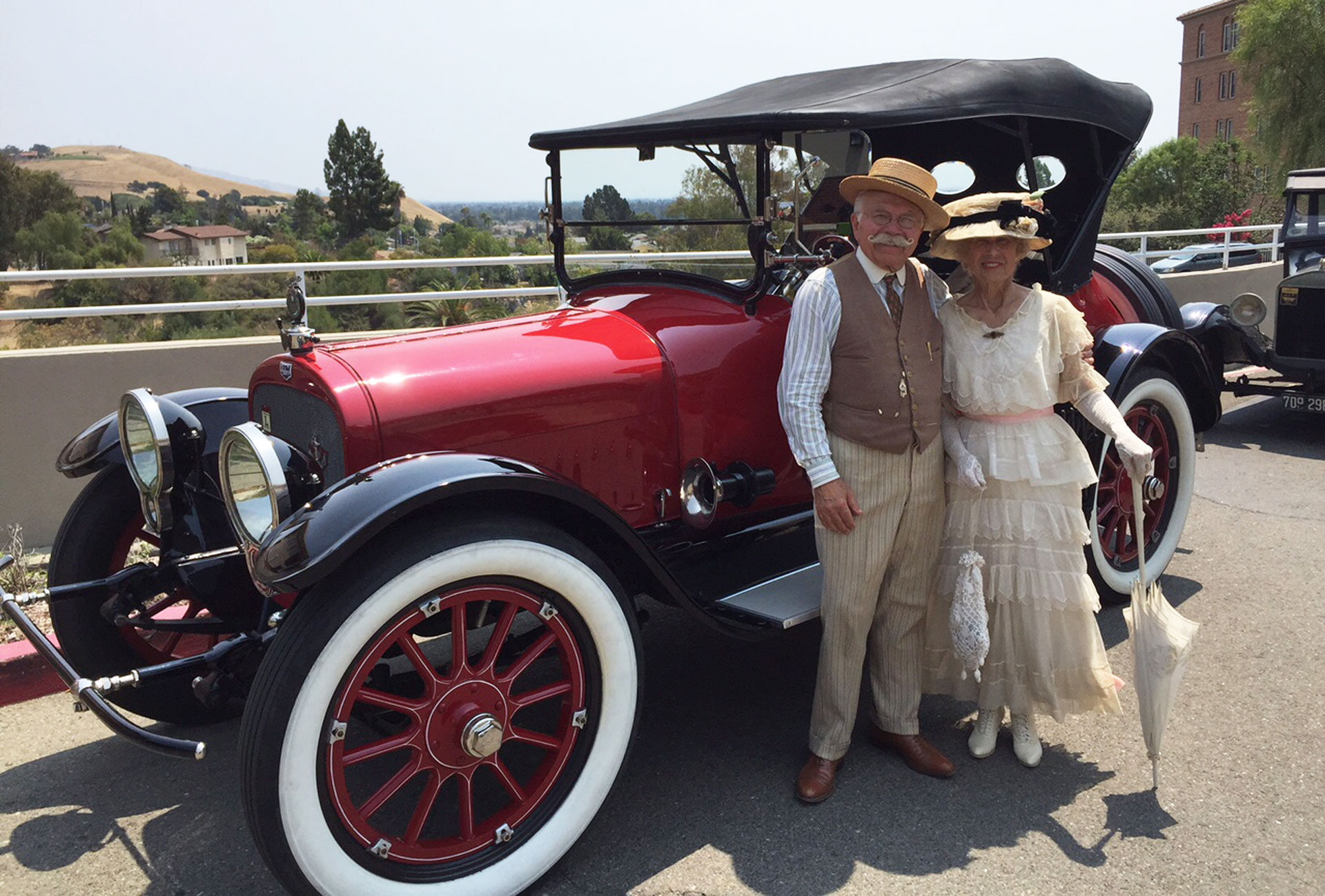 "Ed and Karen Archer show off their classic 1917 Auburn on a recent visit to a senior home in Union City. Karen Archer says she values the time these cars represent: ""Families were closer and neighbors were closer."""