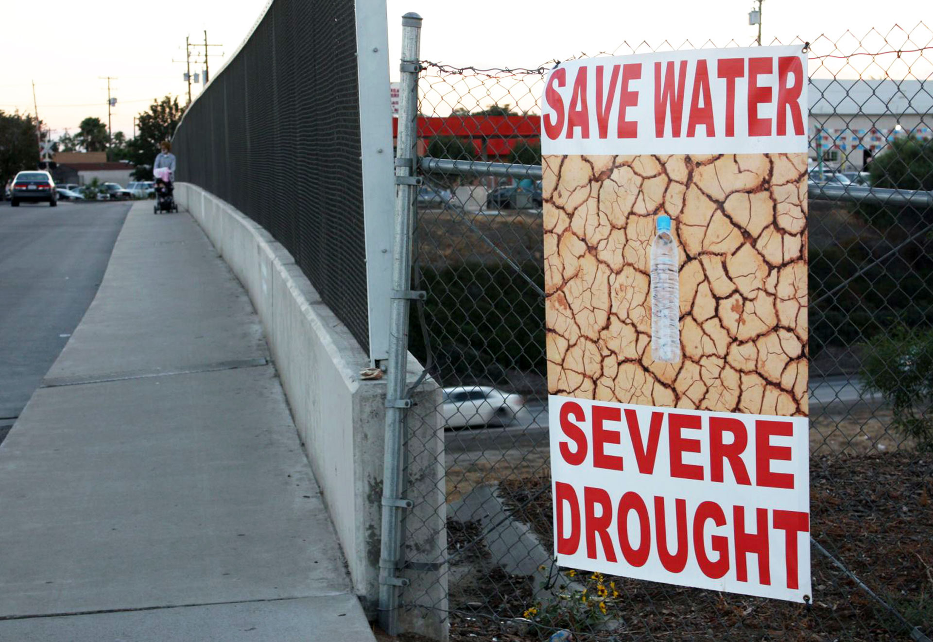 A banner urging residents to save water hangs in the city of Livingston. The town was supposed to cut water use by 32 percent, but so far it hasn't even hit the 10 percent mark.