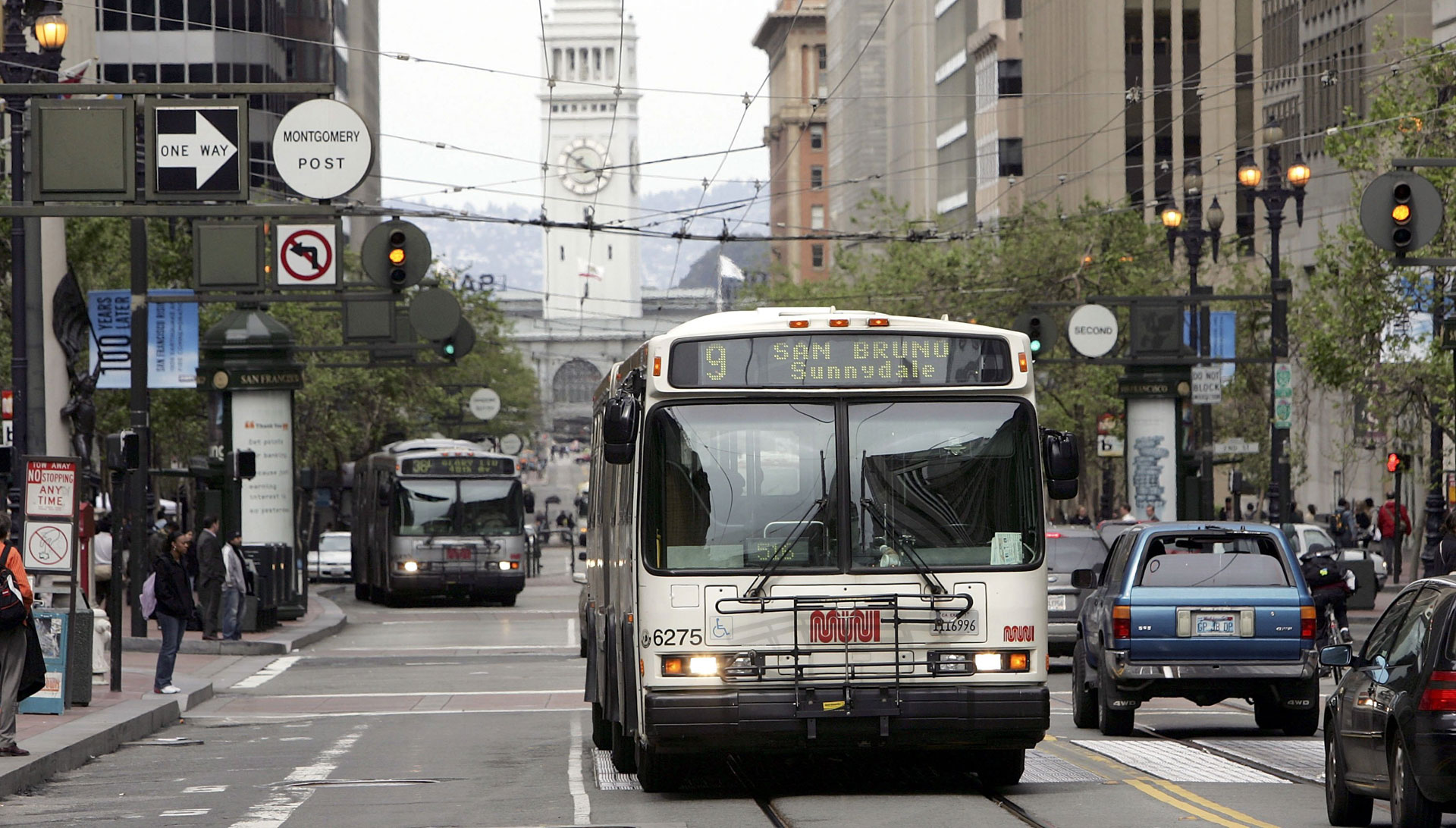 A Muni bus travels down Market Street in San Francisco.