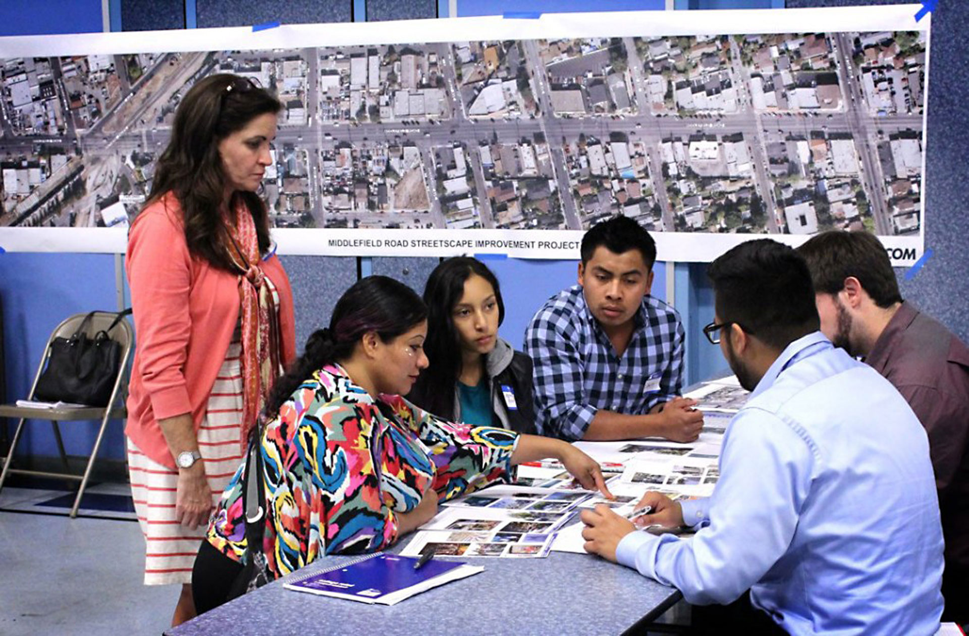 Community members and consultant Millette Litzinger (L) discuss plans for a redesigned Middlefield Road at a design workshop in North Fair Oaks on Sept. 30, 2015.