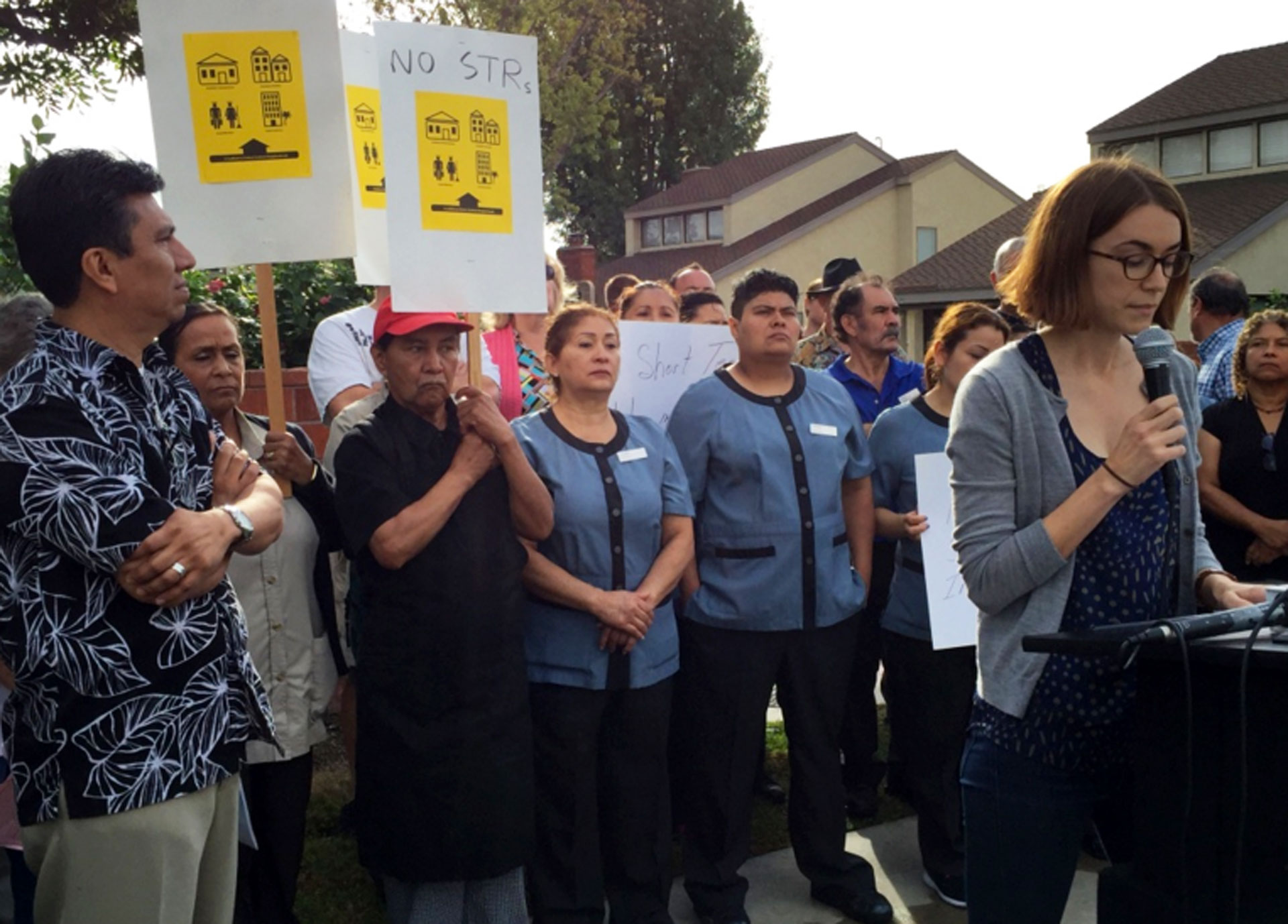 Hotel union workers attend a press conference Monday in a South Anaheim neighborhood organized by an Orange County community activist group petitioning officials to ban short-term rentals.