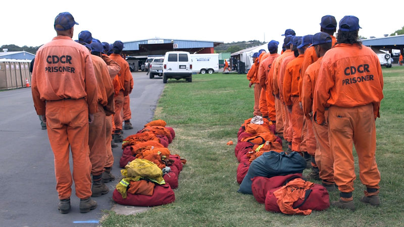 An inmate firefighter crew returns to base camp in Redding, Calif. after a 24-hour shift fighting the Bully fire.