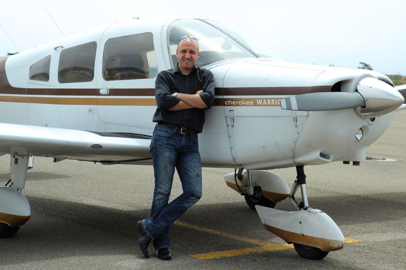 Jassen Todorov stands in front of his plane, a four-seater 1976 Piper Warrior that can fly almost six hours at a stretch.
