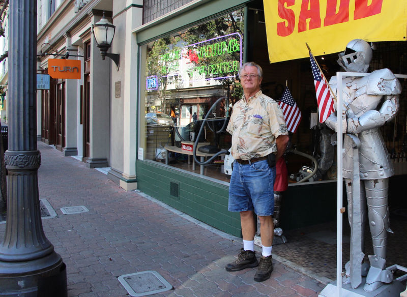 Ralph Garcia stands in front of his Ralph's Vacuum & Sewing Center on Main Street, which opened in 1978.