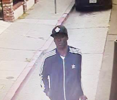 """The Oakland Police Department released this image from a surveillance videotape of a """"person of interest"""" in the fatal September shooting of mural artist Antonio Ramos."""