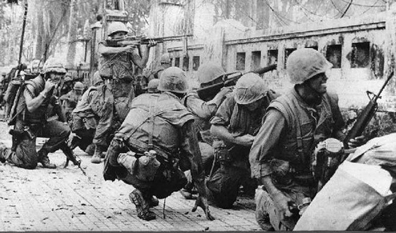 U.S. Marines taking sniper fire in Hue during the Tet Offensive.