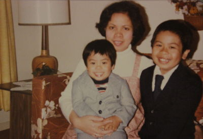 From left to right: Dominic's brother John, Connie, and Dominic at 8 years old.