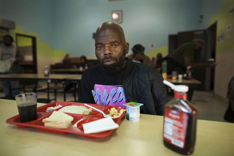 """In this file photo from April 2014, Calvin Henderson attended breakfast service at Mother Brown's Dining Room. """"I've been up all night,"""" he said."""